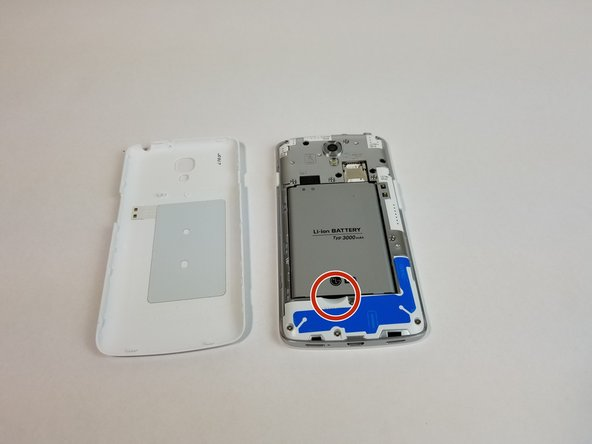 With your finger, pry the battery out through the crease made for removal.