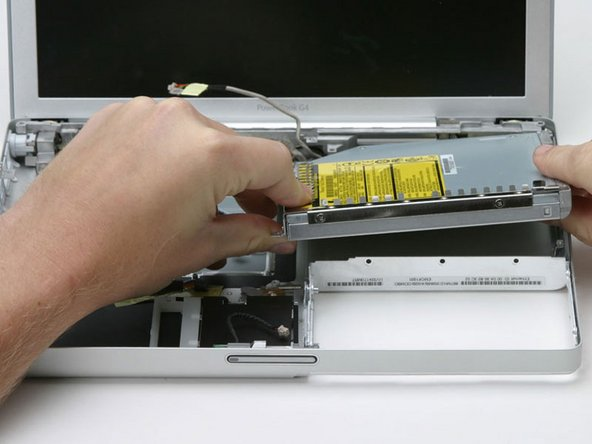 Lift the optical drive up by its front left corner and pull it out of the computer.