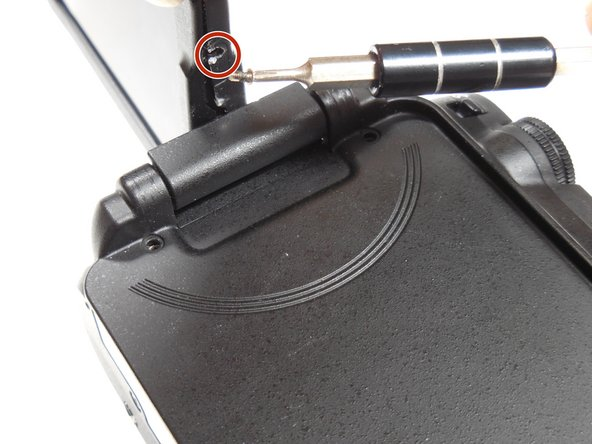 Remove the 4.3 mm screw on the side of the casing using the Phillips #00 screwdriver.
