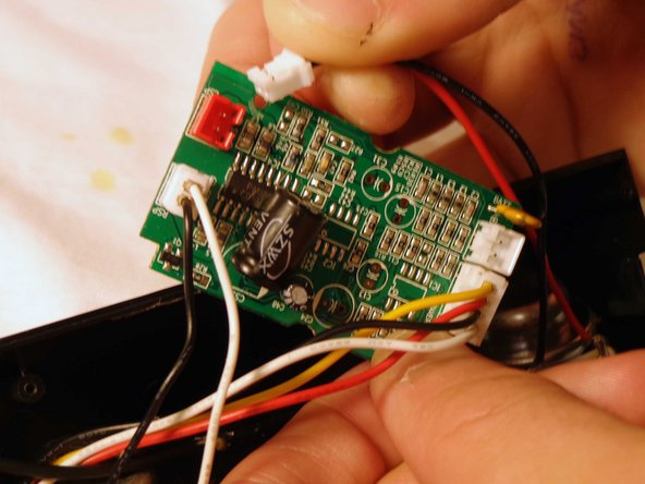 Remove the battery plug from the circuit board by pulling out the plugs to fully remove back panel.