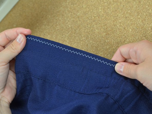 Guide the fabric through the machine to keep the stitch straight.