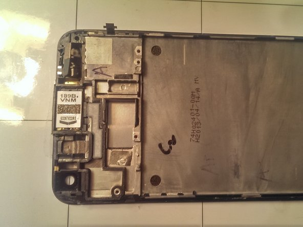Image 1/2: First transfer the earpiece, power button, and spacer onto the new screen assembly
