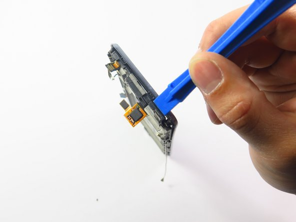 Use the plastic opening tool to remove front glass cover carefully. Try not to break the connector.