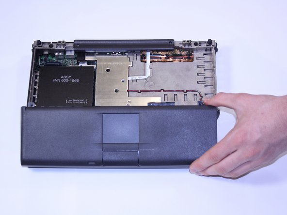 Gently lift up the laptop's front-most panel and slowly raise the trackpad from the logic board.