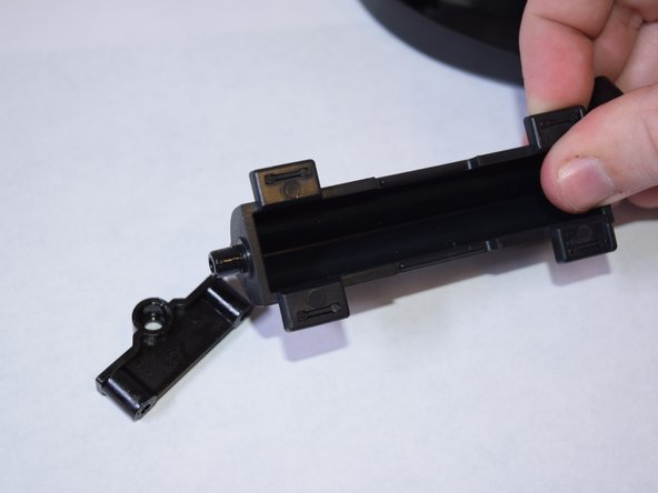 Once the Strum Bar is removed, there is a rectangular piece on the end which can be removed to apply lubricant if needed.