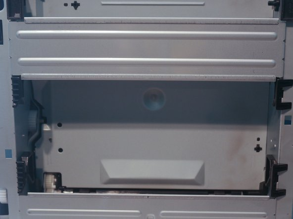 The duplexer tray can be removed by pulling outwards on the blue green blue-green tab, which releases the magnets that hold the tray in place.