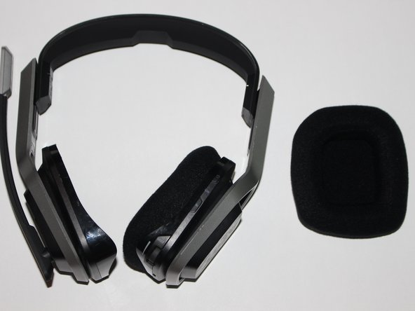 Lift and remove the speaker from the headset.
