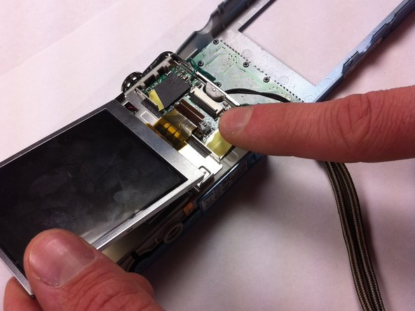 Image 2/2: The yellow ribbon is attached to the right side of the screen and goes to a black connector piece.