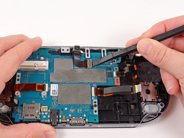 Release the camera flex cable socket by prying up on the tab with a spudger.