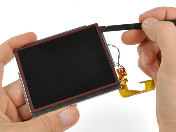 In the same manner as previously described, remove the adhesive along the right edge of the upper LCD.