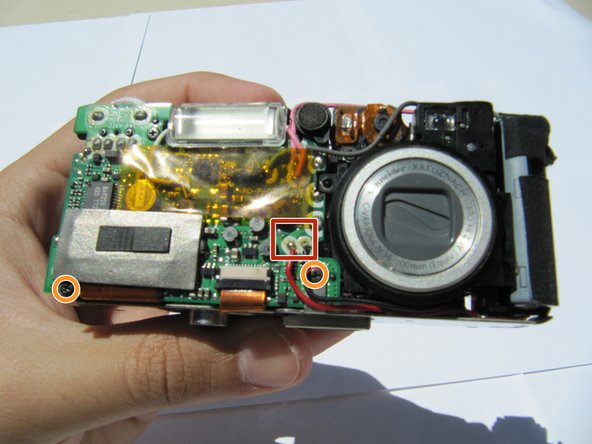 The capacitor can store electricity even when the camera is off! Do not touch it until you have safely discharged it.