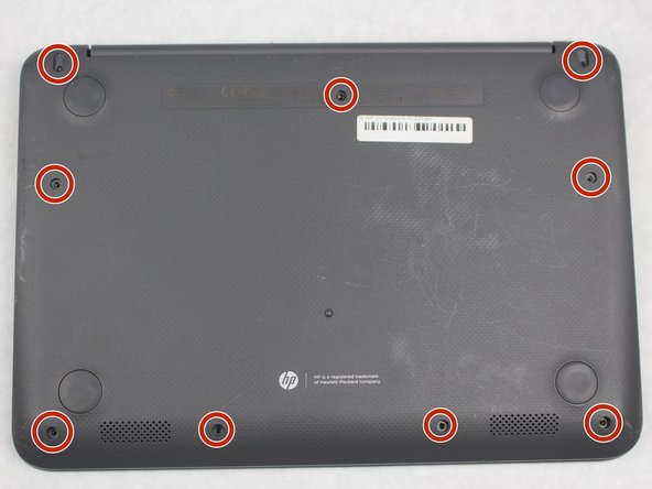 Position your closed laptop face down to remove the 9 visible 6mm screws using the Phillips #1 screwdriver.