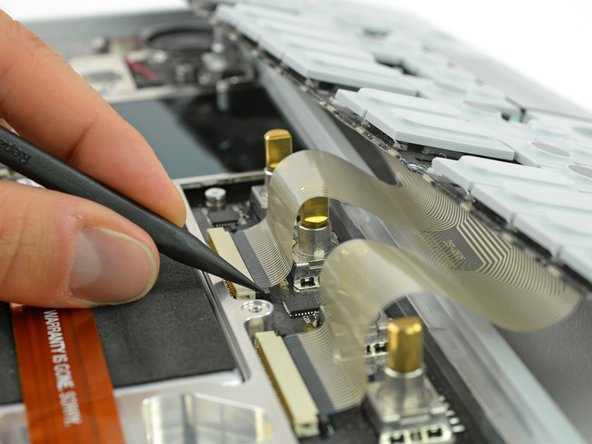 Image 1/2: Now you can pull the flex cables out and remove the keyboard completely.