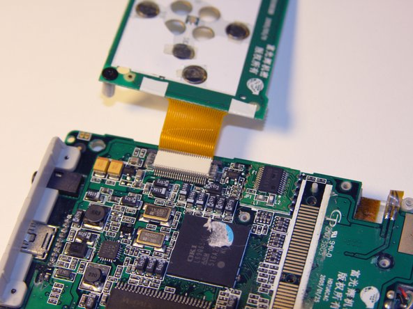 Flip over the motherboard with the button module still attached.