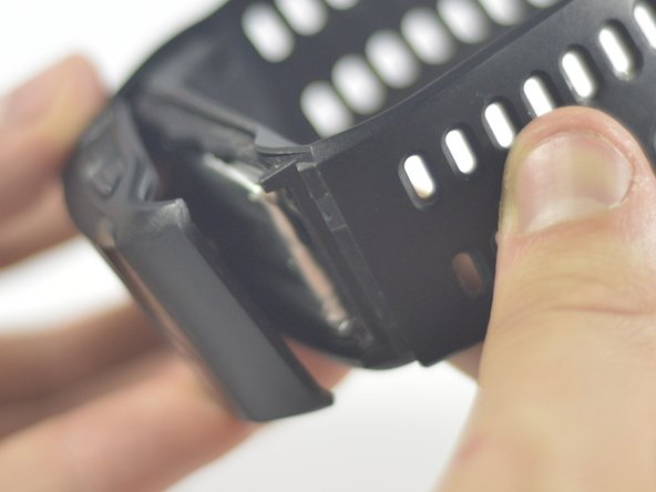 Carefully separate the watch by pulling the band away from the main board.