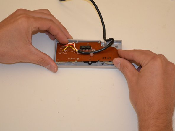 Gently remove the circuit board from the controller face. Use a non marring object to lever up board if it is stuck.