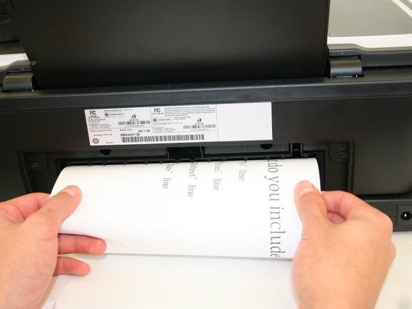 If there is any paper stuck inside, remove it. If not, snap the unit back onto the printer.