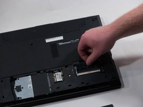 After the notches are moved outwards, the RAM will pop up and it can be pulled out.