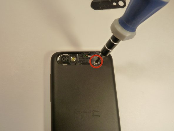 Remove both screws securing on the back case.
