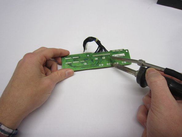 Unsolder the push button. You can push it out or maybe use some plyers.