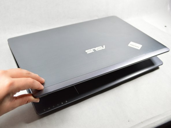 Flip the laptop right-side up and open the screen.