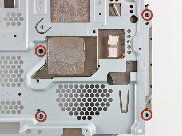 Remove the four 9.5 mm Phillips screws securing the heat sink to the top shield.
