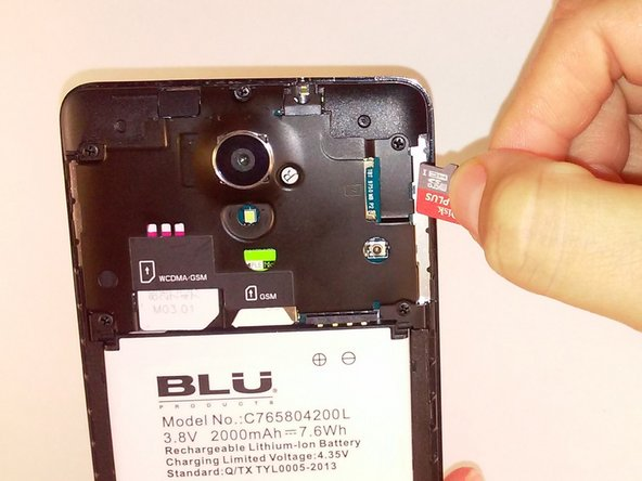Remove the microSD and SIM card. Gently tug on the microSD and SIM card to slide them out of their insert.
