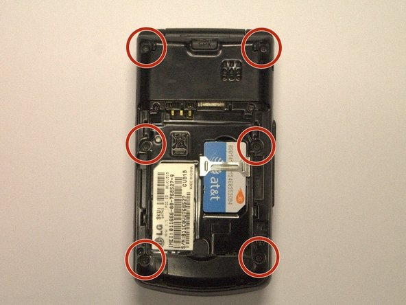 Use a small Phillips head screwdriver to remove the six 3mm screws identified in the photo.