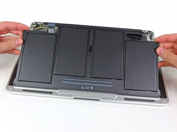 When handling the battery, avoid squeezing or touching the four exposed lithium polymer cells.