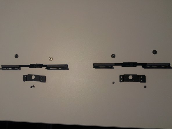 To remove the bottom screen attachment locking mechanism, remove the 8 screws and lift the pieces out.
