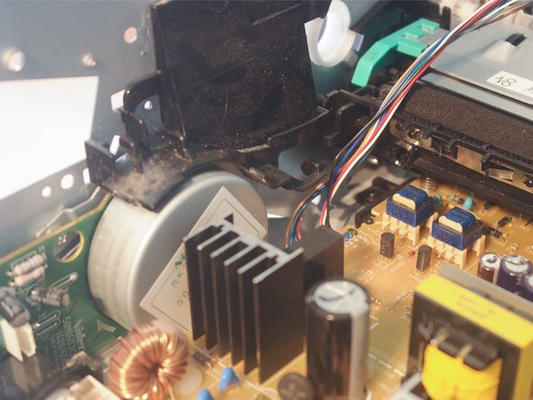 The high voltage corona wire used to apply a charge to the paper is visible in the right of these pictures (the spiked metal strip attached to the paper feed assembly)