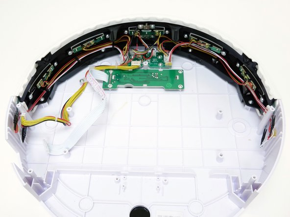 All of bObi's wall detection sensors are plugged in to a small circuit board on the underside of the cover.