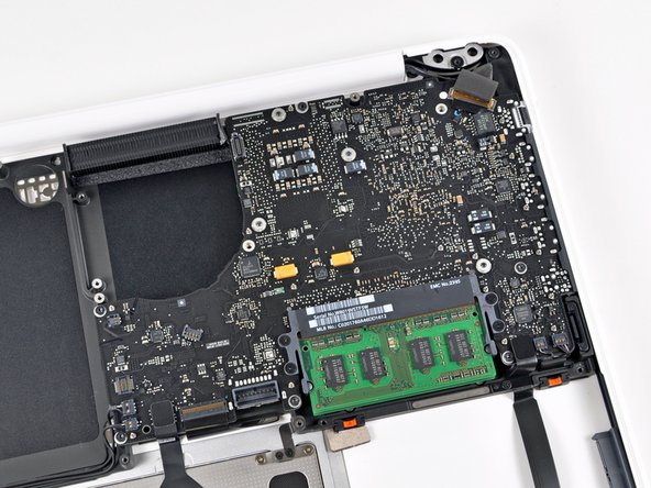 Image 1/3: Obviously the logic board needs to come out, or else this isn't a teardown.