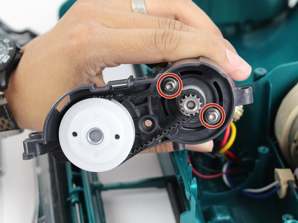 Loosen the two screws by rotating counter clockwise with a T15 Torx screwdriver.