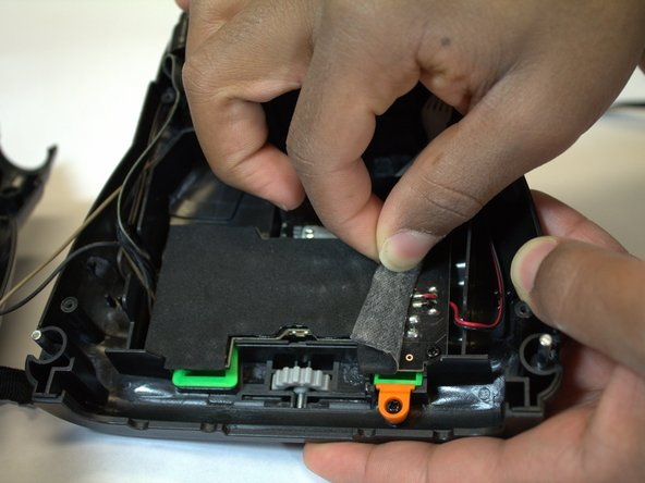 Use your fingers to peel off the foam pad that covers the main circuit board.