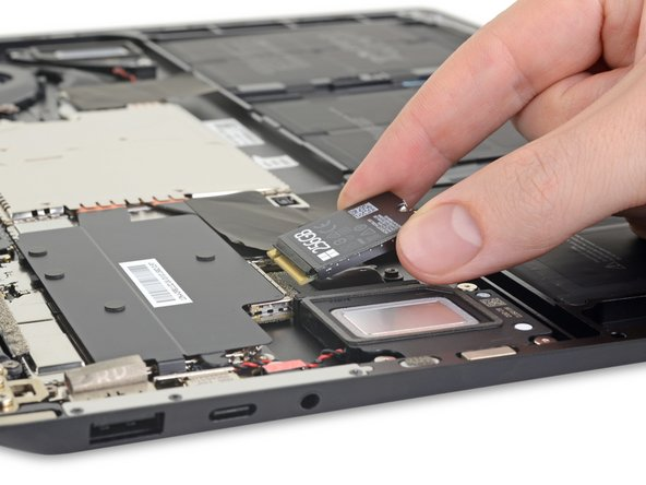 First thing we spot with that magnet-y top cover assembly out of the way: the removable SSD. If we hadn't already seen this in Microsoft's keynote presentation, we'd probably be passed out in our chairs by now.