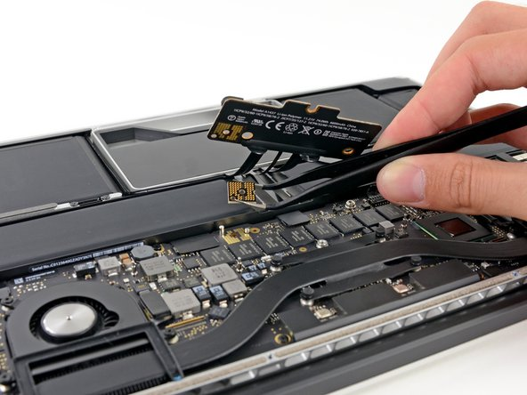 Instead of the good ol' run-of-the-mill battery connector that we've seen in most other Apple laptops, the battery is connected using several screws that hold a connector board in place.