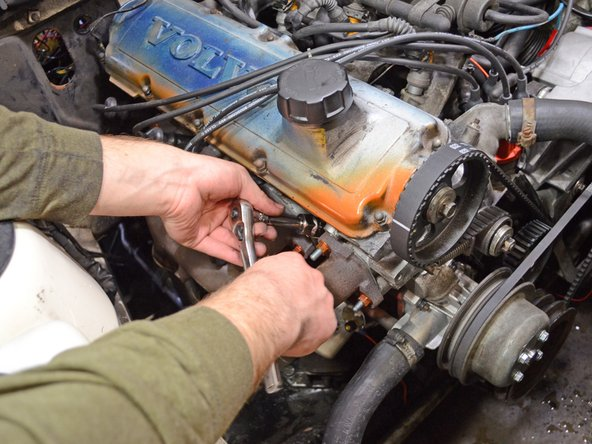 "Place a 13/16"" spark plug socket over the spark plug and make sure the spark plug is securely seated in the socket."