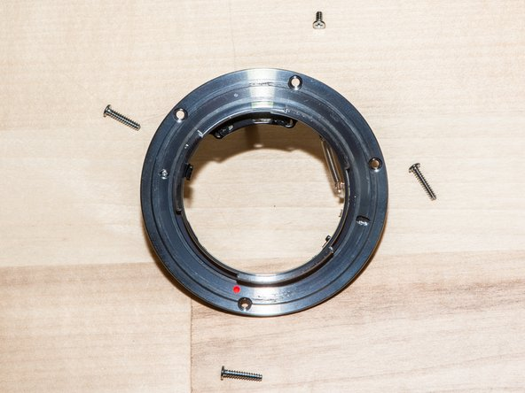 Remove the four spacer rings below the mounting plate. Be careful not to bend the brass rings.