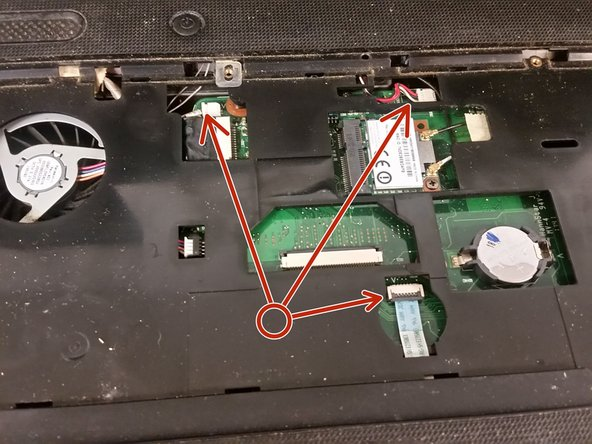 Remove the three palmrest cables from the motherboard, that being the power button cable, the speaker cable, and the touchpad cable.