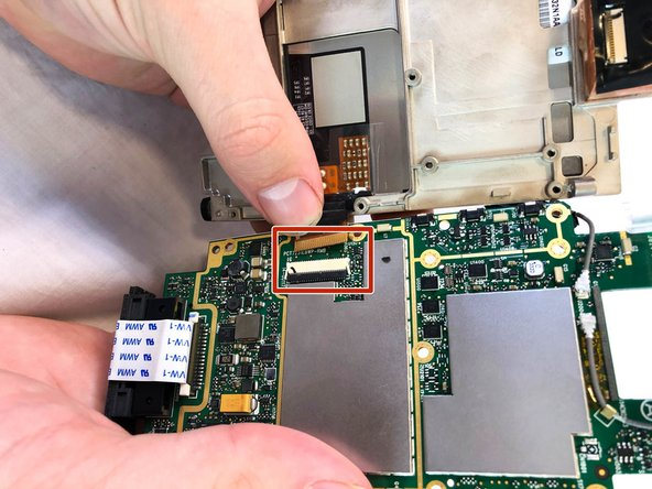 Open the LCD connector and remove the cable.