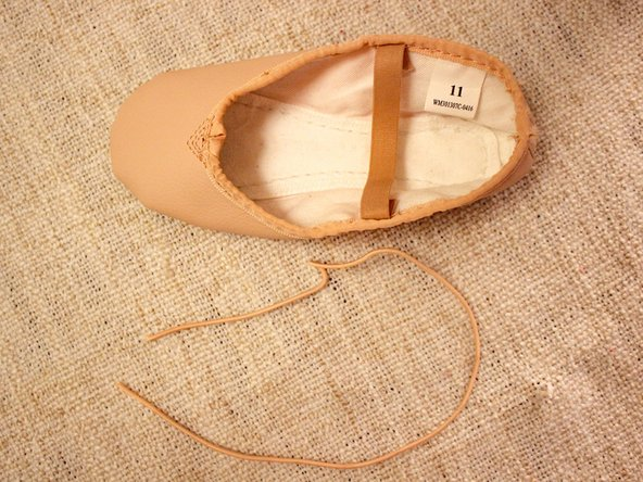 Remove all of the elastic out of the shoe completely by gently pulling one end