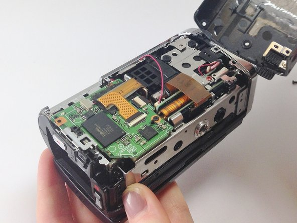 Image 2/3: The inside of your camcorder should now be completely exposed, as shown in the photos.