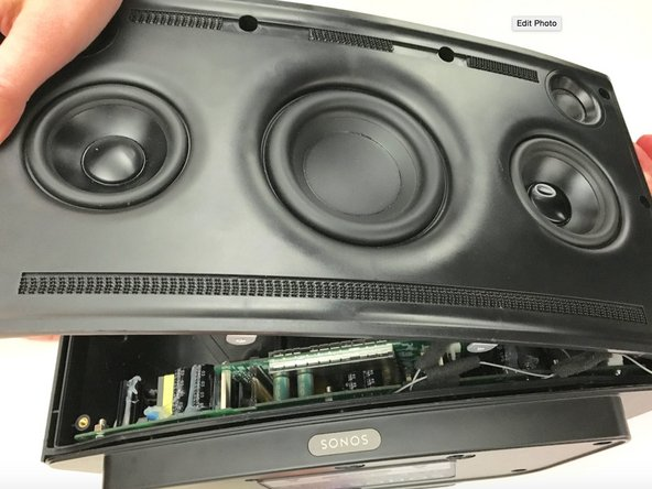 While removing the front speaker panel, pay close attention to the bottom right-hand corner. There will be an antenna connector you will need to remove in the next step.