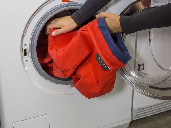 Fill the washing machine. For optimal results you should wash similar colors together and turn the items inside out before washing.