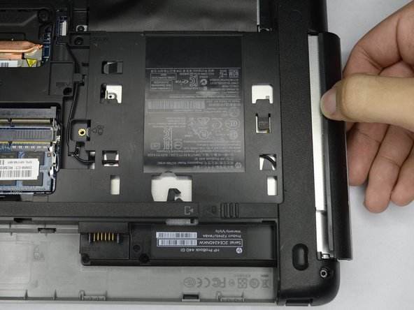 Slowly remove the optical drive, by pulling it straight out of the slot.