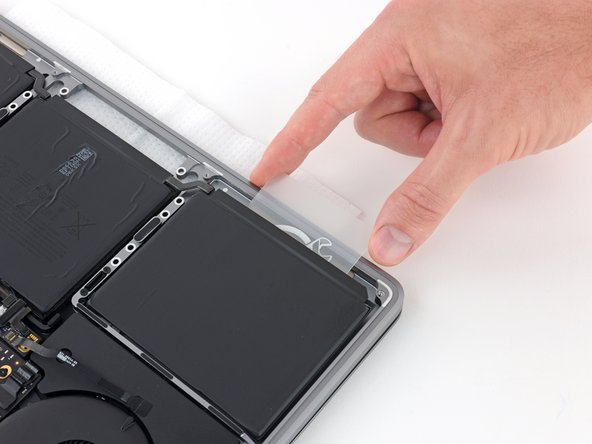 This should not require much force—the adhesive remover does most of the work. If you aren't able to get your card under the battery cell, apply a bit more adhesive remover as instructed above and wait 2-3 minutes before trying again.