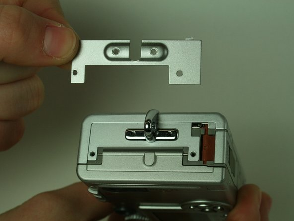 Remove the two small metal plates, which the four screws held in place.
