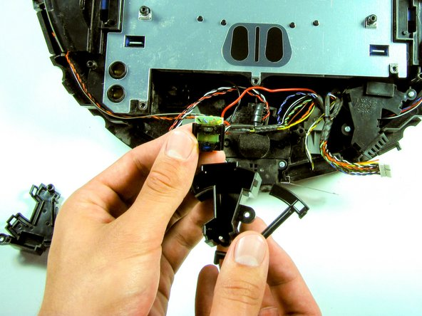 Once the bumper sensor module is open, remove the small IR chip.