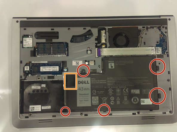 Use a Phillips J0 screwdriver in order to remove the screws indicated by the markers in the picture. It will be a total of 5 screws. Careful not to puncture the battery.